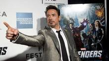 "Robert Downey Jr. poses as he arrives at the screening of the film ""Marvel's The Avengers"" for the closing night of the 2012 Tribeca Film Festival in New York in this April 28, 2012 file photo. After six consecutive increases, summer ticket sales in the United States and Canada are running 5 percent behind last year's record, according to the box office division of Hollywood.com. (ANDREW KELLY/Reuters)"