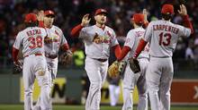 St. Louis Cardinals players celebrate after defeating the Boston Red Sox, 4-2, in Game 2 of baseball's World Series (Associated Press)