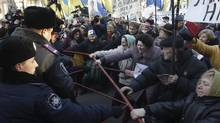 Supporters of former opposition leader Yulia Tymoshenko confront the police at a protest in Kiev on Monday. (Sergei Svetlitsky/Reuters)