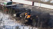 Derailed train cars burn in Plaster Rock, N.B., Wednesday, Jan.8, 2014. (Tom Bateman/THE CANADIAN PRESS)