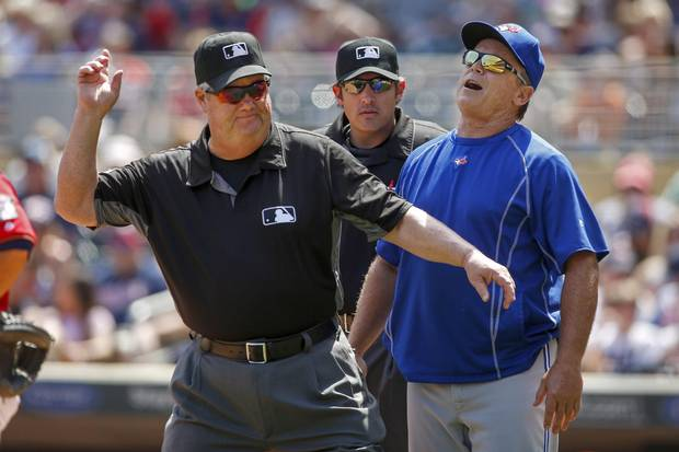 Toronto Blue Jays manager John Gibbons, right, is ejected on Sunday in Minneapolis. It was his fourth ejection of the season.
