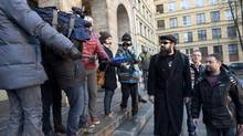 Activist Alexandre Paul, third from right, is expected to arrive in Montreal on Friday. (REUTERS)