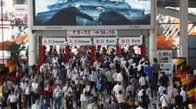 Visitors walk through an entrance to the China Import and Export Fair, also known as the Canton Fair, in the southern Chinese city of Guangzhou. (BOBBY YIP/REUTERS)