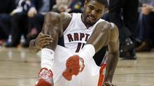 Toronto Raptors Amir Johnson holds his leg during the first half of their NBA game against the Milwaukee Bucks in Toronto, January 13, 2013. (MARK BLINCH/REUTERS)