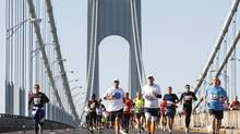 Runners cross the Verrazano-Narrows Bridge after the start of the 2011 New York City Marathon in New York, November 6, 2011. (Brendan McDermid / Reuters/REUTERS)
