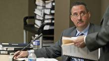 Lieutenant-Colonel Gilles Sansterre, commander of the National Investigations Service, speaks with a Military Police Complaints Commission lawyer during a break in testimony on April 12, 2010, in Ottawa. (Pawel Dwulit/THE CANADIAN PRESS)