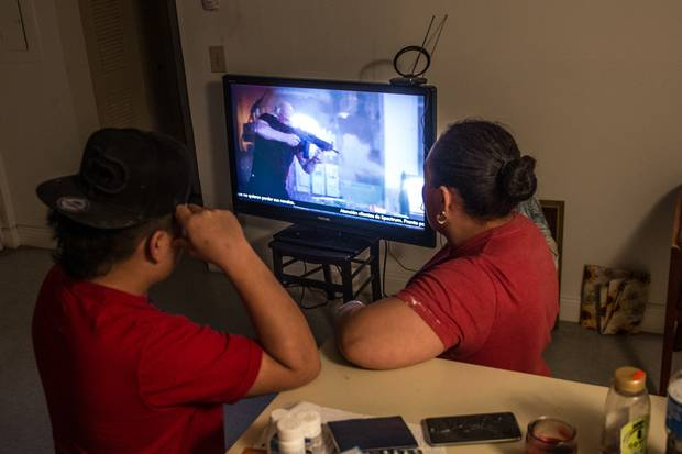 Fernando and his aunt watch TV. In order to release Fernando from a youth detention centre, his aunt had to identify herself to the Department of Homeland Security, meaning authorities will know where to find her if she is deported.