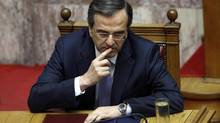 Greek Prime Minister Antonis Samaras gestures during a parliamentary session in Athens July 6, 2012. (JOHN KOLESIDIS/REUTERS)