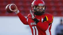 University of Calgary Dinos quarterback Eric Dzwilewski is the Canada West nominee for the Hec Crighton Award after he completed 154 of 218 passes on the season for 2,290 yards and 15 touchdowns. His 70.6 completion percentage was the best in Canada and set a Canada West record. (TODD KOROL/REUTERS)