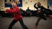 Kids who play active video games are no more active than kids who do not. kids who played Dylan Burger, 8, (L) dances to a video game at the Boys & Girls Club in Santa Monica, California December 16, 2011. REUTERS/Lucy Nicholson (UNITED STATES - Tags: SOCIETY) (Lucy Nicholson/REUTERS)