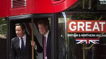 """Britain's Prince Harry (R) and British Prime Minister David Cameron arrive on London's new double-decker Routemaster bus to """"The Great Event"""" to meet entrepreneurs in Manhattan May 14, 2013. (BRENDAN MCDERMID/REUTERS)"""