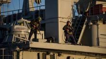 Ukrainian seamen stand guard on the Ukrainian navy ship Slavutich in Sevastopol harbour, March 3, 2014. (Andrew Lubimov/AP)