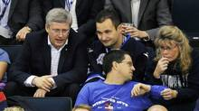 Canada's Prime Minister Stephen Harper (L) watches the game between the Winnipeg Jets and Montreal Canadiens during the first period of their NHL hockey game in Winnipeg, Manitoba, October 9, 2011. The Winnipeg Jets are playing their first season game since the franchise left the city 15 years ago. (Fred Greenslade/Reuters/Fred Greenslade/Reuters)