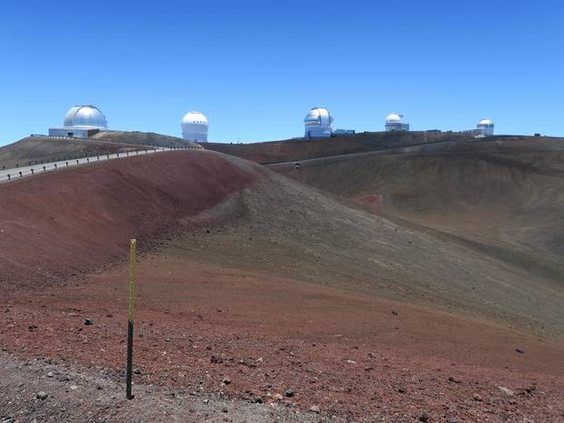 There is already significant observatory infrastructure atop the dormant volcano Mauna Kea, Hawaii, but the Thirty Meter Telescope project has its critics.