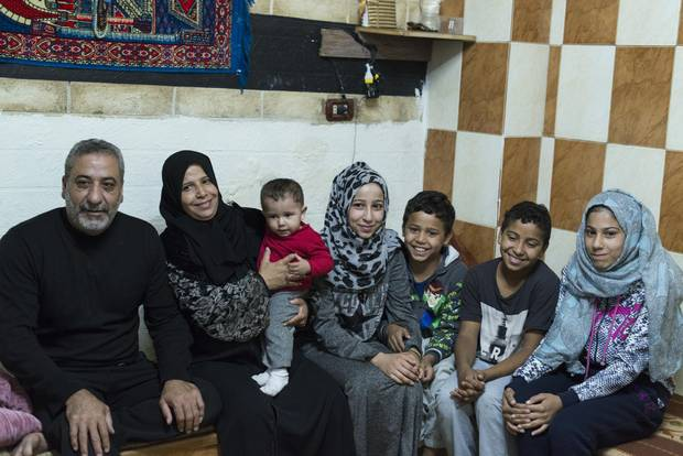 Ahmad, Muna and their five children in an apartment in Amman. The family escaped the conflict in Syria in 2013 and currently rely on monthly cash assistance.