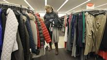 A shopper checks winter jackets on a Nordstrom rack in Chicago. Total U.S. consumer debt rose 0.3 per cent to $11.34-trillion (U.S.) in the fourth quarter of last year compared to the previous quarter. (Nam Y. Huh/AP)