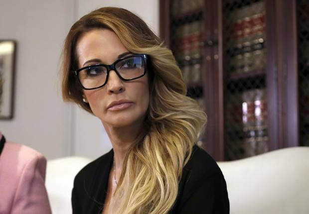 Jessica Drake listens to a question during a news conference at the office of her attorney, Gloria Allred, in Los Angeles on Oct. 22, 2016.