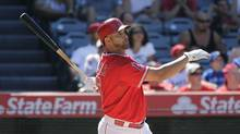 Los Angeles Angels' Albert Pujols watches his two-run home run during the seventh inning of a baseball game against the Toronto Blue Jays on Wednesday, July 9, 2014, in Anaheim, Calif. (Jae C. Hong/AP)