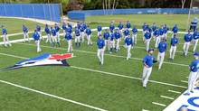 Toronto Blue Jays players start their morning workouts at the team's MLB baseball spring training facility in Dunedin, Florida February 14, 2013 (FRED THORNHILL/REUTERS)