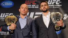 Georges St-Pierre, left, squares off with Carlos Condit following a news conference in Montreal, Thursday, September 27, 2012, where they announced their upcoming UFC 154 fight which will take place in Montreal on November 17. (Graham Hughes/THE CANADIAN PRESS)