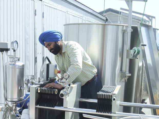Karnail Sidhu filters wine at his winery, Kalala, in Kelowna, B.C. Kalala has steadily expanded since its establishment in 2006, with its wines now available across British Columbia as well as going overseas to China and India. Sidhu emphasizes the importance of using high-quality, organic ingredients in his wines.