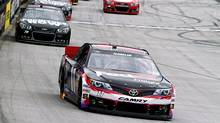 Denny Hamlin (11) leads driver Kurt Busch (78) during the NASCAR Sprint Cup Series Food City 500 auto race on Sunday, March 17, 2013, in Bristol, Tenn. (Wade Payne/AP Photo)