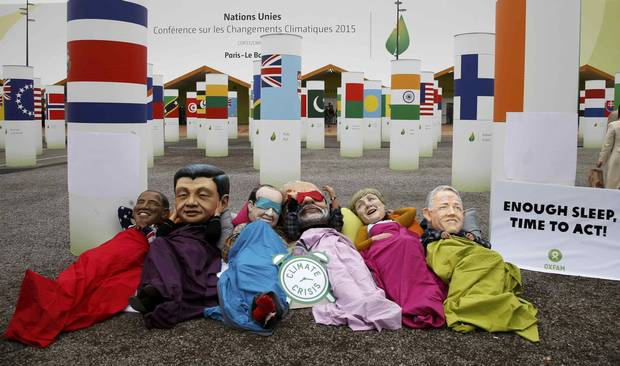 Activists from global anti-poverty charity Oxfam wear masks depicting U.S. President Barack Obama, Chinese President Xi Jinping, French President François Hollande, India's Prime Minister Narendra Modi, German Chancellor Angela Merkel, and Australia's Prime Minister Malcolm Turnbull.