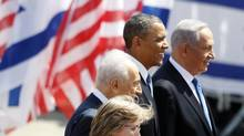 U.S. President Barack Obama stands with Israel's President Shimon Peres and Prime Minister Benjamin Netanyahu after landing at Ben Gurion International Airport near Tel Aviv March 20, 2013. (Darren Whiteside/Reuters)