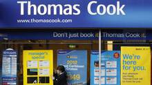A worker changes the window display of Thomas Cook in Loughborough, central England December 14, 2011. (DARREN STAPLES/DARREN STAPLES/REUTERS)