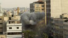 Smoke is seen after an Israeli air strike, witnessed by a Reuters journalist, on a floor in a building that also houses media offices in Gaza City Nov. 19, 2012. Israeli missiles blasted a tower block that houses many international media for a second straight day on Monday, targeting a computer shop in the building, witnesses said.  (Ahmed Jadallah/Reuters)