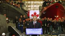 Canadian Prime Minister Stephen Harper speaks to workers at the Halifax Shipyard in Halifax, Nova Scotia. Harper announced an agreement in principle for the yard to construct warships for the Canadian Navy. (Paul Darrow/Reuters)