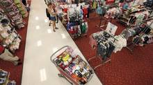 A shopper fills her cart at a Target store Thursday, July 5, 2012, in Chicago. (M. Spencer Green/AP)