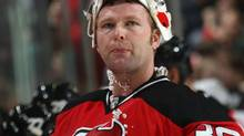 Martin Brodeur #30 of the New Jersey Devils takes a break in the action in his game against the Tampa Bay Lightning at the Prudential Center on December 4, 2009 in Newark, New Jersey. The Devils defeated the Lightning 3-2. (Photo by Bruce Bennett/Getty Images) (Bruce Bennett/2009 Getty Images)
