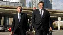 NHL commissioner Gary Bettman (L) and Murray Edwards, co-owner of the Calgary Flames photographed while walking on Bay in the middle of the negotiations with the NHL aimed to end the lockout, Toronto October 18 2012. (Fernando Morales/The Globe and Mail)