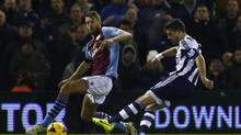West Bromwich Albion's Shane Long, right, shoots and scores his goal against Aston Villa during their English Premier League soccer match at The Hawthorns in West Bromwich, central England November 25, 2013. R (EDDIE KEOGH/REUTERS)