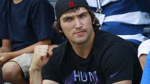 Hockey player Alex Ovechkin watches Maria Kirilenko of Russia play Andrea Hlavackova of the Czech Republic during their women's singles match at the U.S. Open tennis tournament in New York September 1, 2012. (KEVIN LAMARQUE/REUTERS)