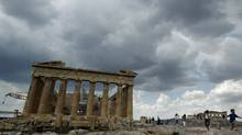 Tourists walk around the temple of the Parthenon at the archaeological site of the Acropolis hill in Athens June 16, 2011. (Yiorgos Karahalis/Reuters/Yiorgos Karahalis/Reuters)