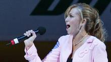 Paulina Gretzky, daughter of Hall of Fame hockey player Wayne Gretzky sings the Canadian national anthem before the World Cup Hockey semifinal game between Canada and the Czech Republic, in Toronto, September 11, 2004. (SHAUN BEST/SHAUN BEST / REUTERS)