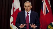 Ontario Energy Minister Bob Chiarelli promises relief for low-income residents when the Clean Energy Benefit ends. (Matthew Sherwood/The Canadian Press)