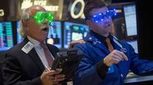 Traders, wearing novelty 2014 glasses, trade at the closing bell on the floor of the New York Stock Exchange on New Year's Eve in New York, December 31, 2013. (CARLO ALLEGRI/REUTERS)