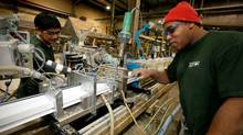 Workers at the Acrylon Plastics' manufacturing plant in Winnipeg (John Woods/John Woods for The Globe and Mail)