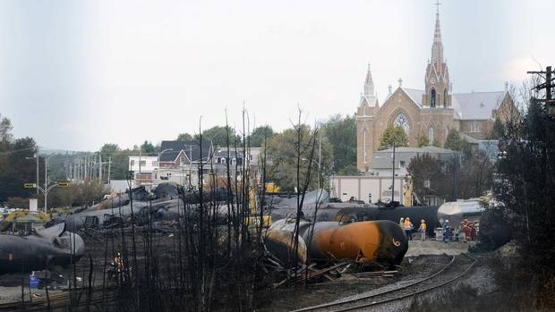 Train cars are pictured on the site of the train wreck in Lac Megantic, July 16, 2013. (Credit: Reuters/Ryan Remiorz/Pool) Click to enlarge.