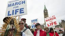 Anti-abortion activists march on Parliament Hill in Ottawa on May 13, 2010.