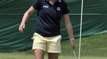 Stacy Lewis of the U.S. smiles after putting on the 18th green during the pro-am round at the Manulife Financial LPGA Classic golf tournament in Waterloo, Ontario, June 20, 2012. (MIKE CASSESE/REUTERS)