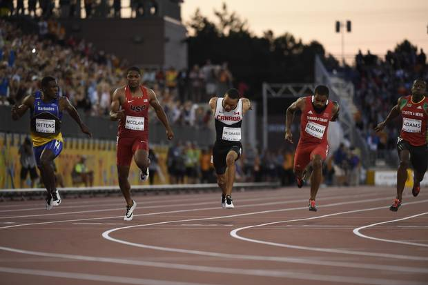 Canadian sprinter Andre De Grasse crosses the finish line first in the men's 100m sprint final during the Toronto 2015 Pan Am Games in July 2015.