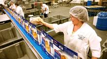 Workers package fish fillets at the High Liner Foods plant in Lunenburg, NS. (PAUL DARROW/Paul Darrow for the Globe and Mail)