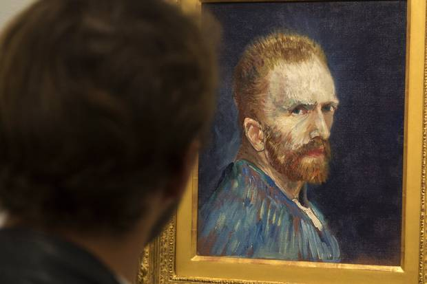 A patron looks at a Van Gogh self-portrait at Montreal's Museum of Fine Arts in 2014.