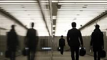 Businessmen walk through an office complex in Tokyo. (YURIKO NAKAO/REUTERS)