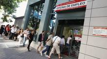 People enter a government-run employment office in Madrid. Spain's registered jobless rate fell by 2.1 per cent in June, from a month earlier, leaving 4.6 million people out of work, data from the Labour Ministry showed on Tuesday. (ANDREA COMAS/REUTERS)