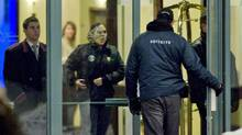 Security personnel guard the entrance to the Chateau Vaudreuil Hotel in Vaudreuil, west of Montreal,on Jan. 27, 2011, where Belhassen Trabelsi is believed to be staying. (Graham Hughes/The Canadian Press)